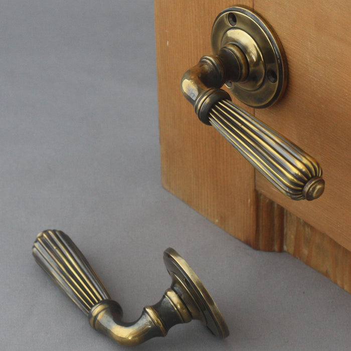 Period brass lever door handles