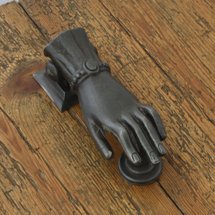 Hand and ball door knocker