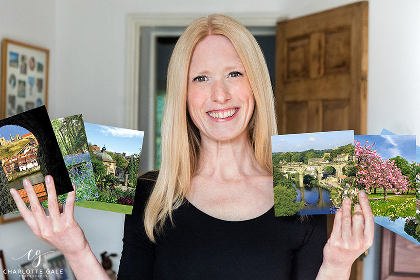 Yorkshire Photographer Charlotte Gale with her range of corporate Christmas cards