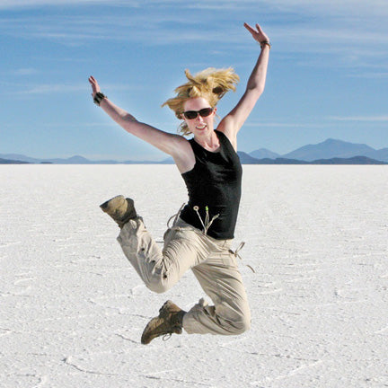 Photographer Charlotte Gale jumping in the Salar Desert