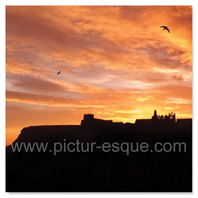Sunrise over St Mary's Church and Whitby Abbey in North Yorkshire