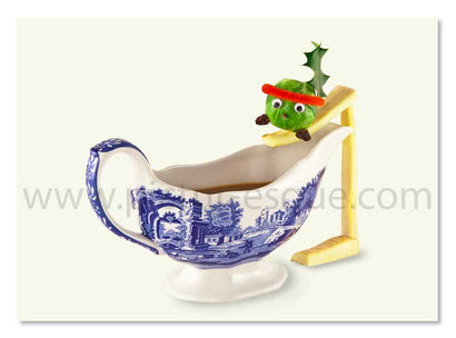 Humorous Christmas card featuring a dressed up sprout preparing to slide into a gravy boat