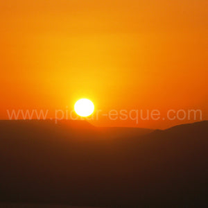 Sunrise over the Dead Sea and Jordan from Masada, Israel.