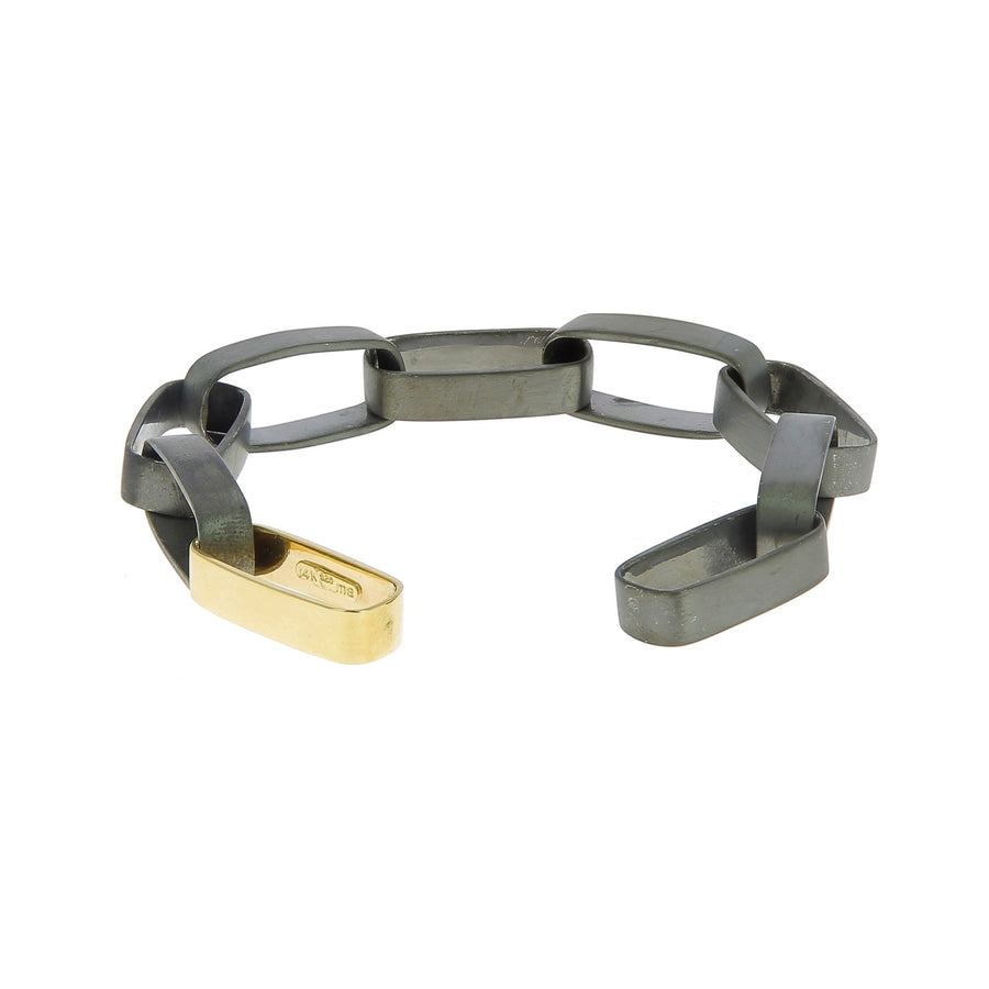Black rhodium silver mega biker bracelet with one yg link