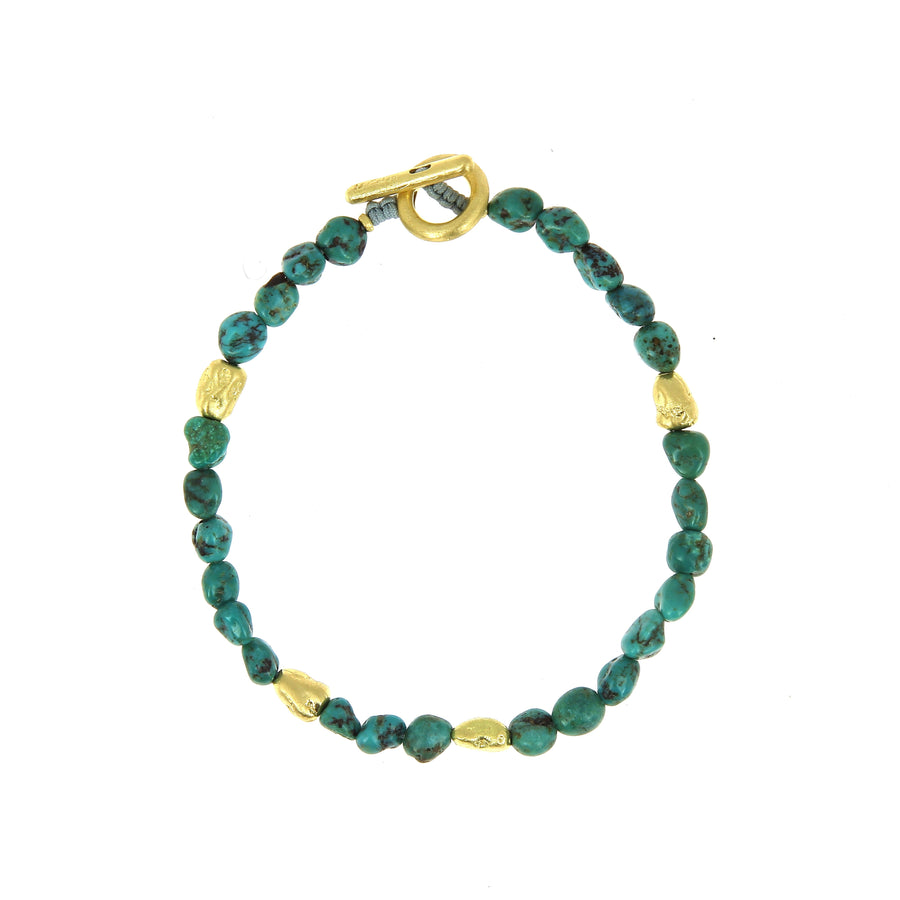 Cut Turquoise Gemstone with Yellow Gold Bracelet