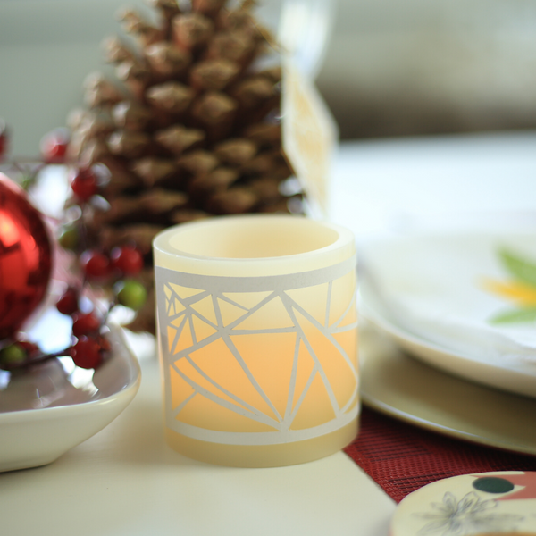 Cut paper wrapped battery-operated candle