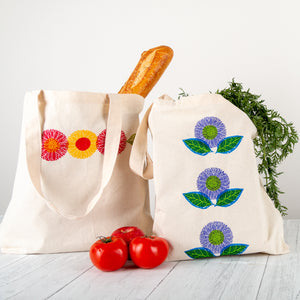 Fabric Stamped Tote Bags shown in Tomato (L) and Plum (R) color palettes
