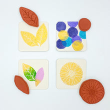Load image into Gallery viewer, Coasters stamped with botanical stamps from Jen Hewett
