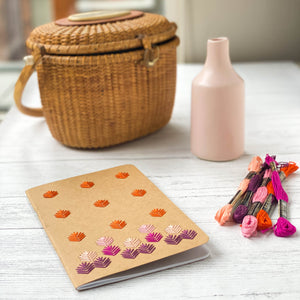 Embroidered kraft notebook, shown in autumn
