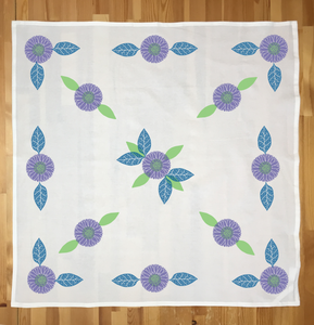 Tea towel stamped with the advanced design in the Plum color palette