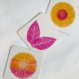 Flower and leaf coasters stamped in Pink and Ochre