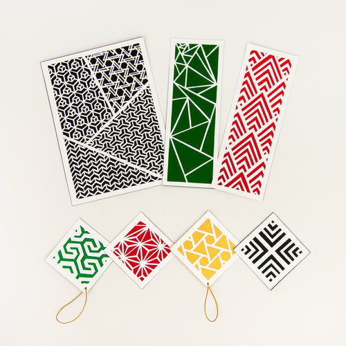 Geometric cut paper patterns shown in Holly color palette