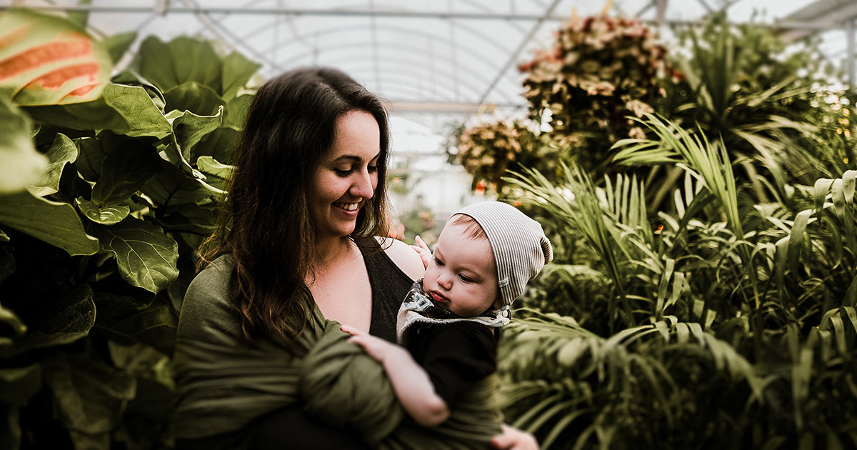 A woman and baby in a greenhouse