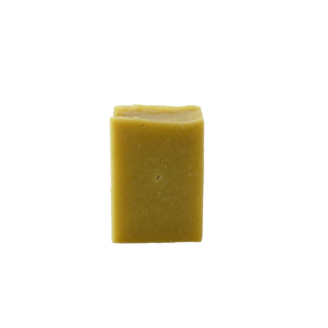 A single yellow rectangular bar of soap on a white background