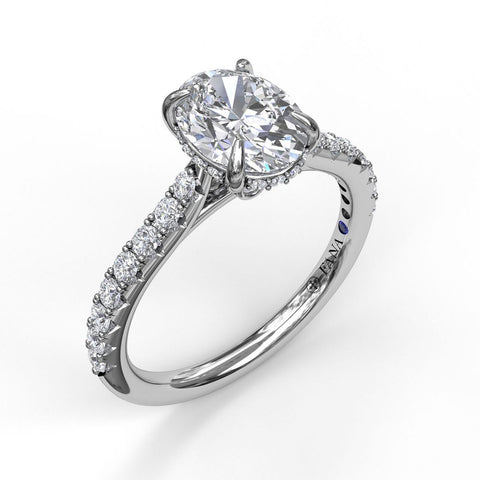 Classic Oval Cut Solitaire With Hidden Halo