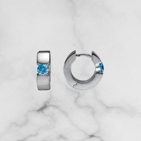 Sterling Silver Huggie Earring with Blue Topaz