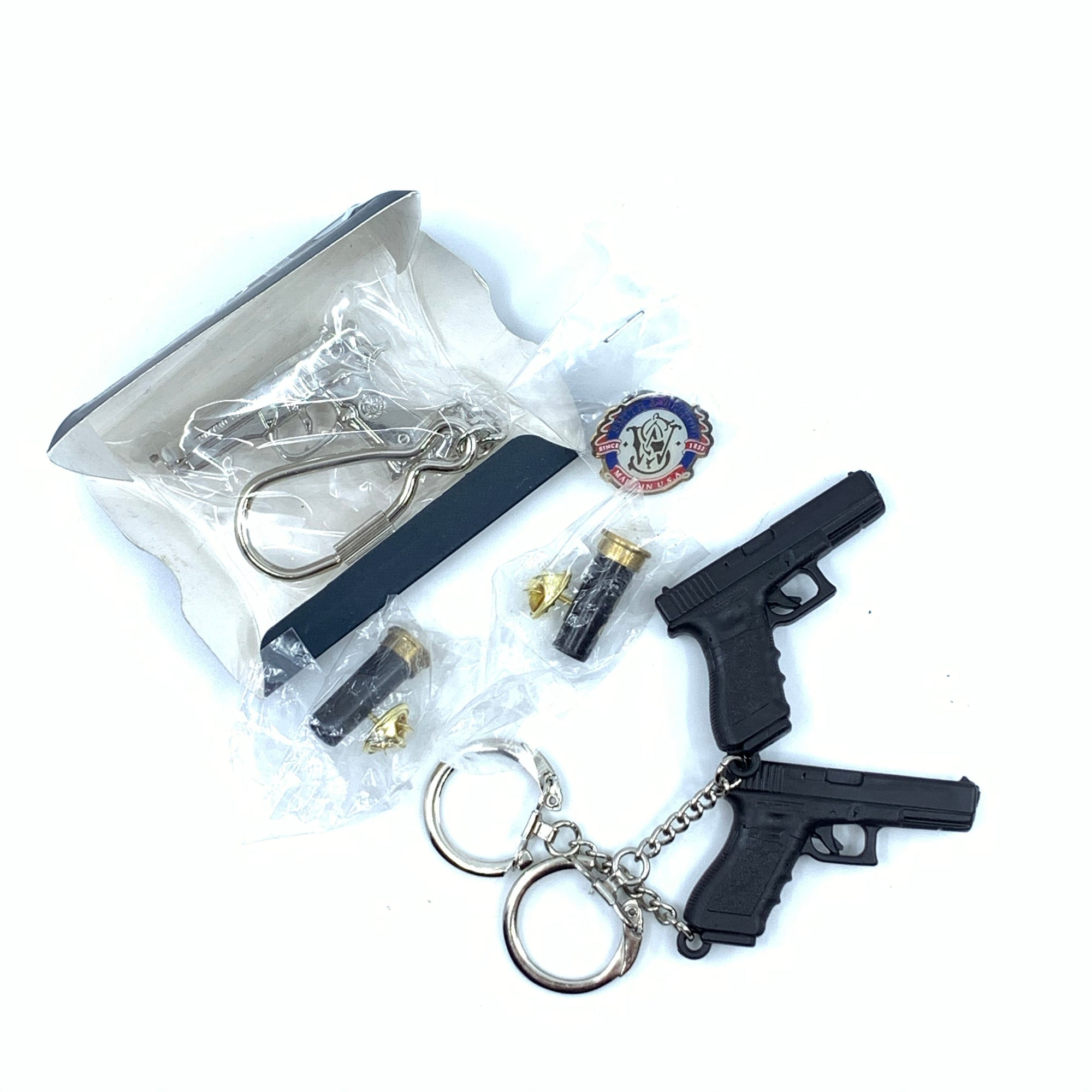 2 Browning Shotshell Lapel Pin, 2 Glock Key Chains, 1 Beretta 92 Key Chain 1 Smith & Wesson Lapel Pin