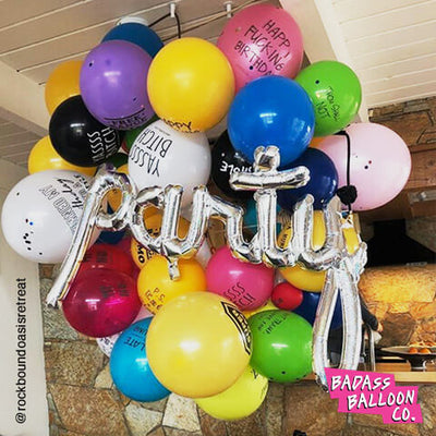 PARTY script silver balloon in a colorful balloon garland. Birthday decoration. Balloons by badassballoonco.