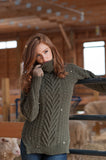 The Gender Neutral Turtleneck Sweater in Forest