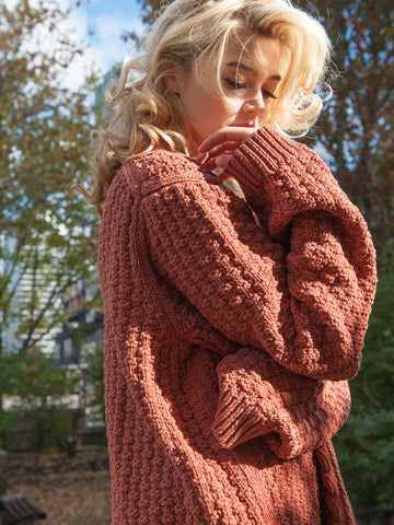 10% OFF: The Vaute Aran Sweater on Her - Copper