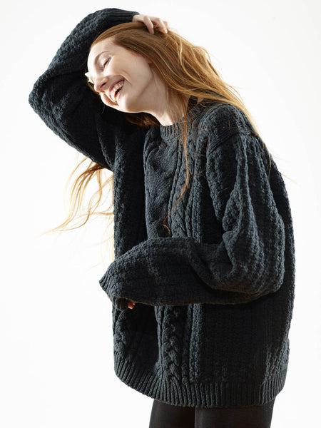 The FW16 Aran Sweater on Her in Black