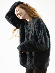 The Vaute Aran Sweater on Her - Black and Cobalt (Pre-Order)
