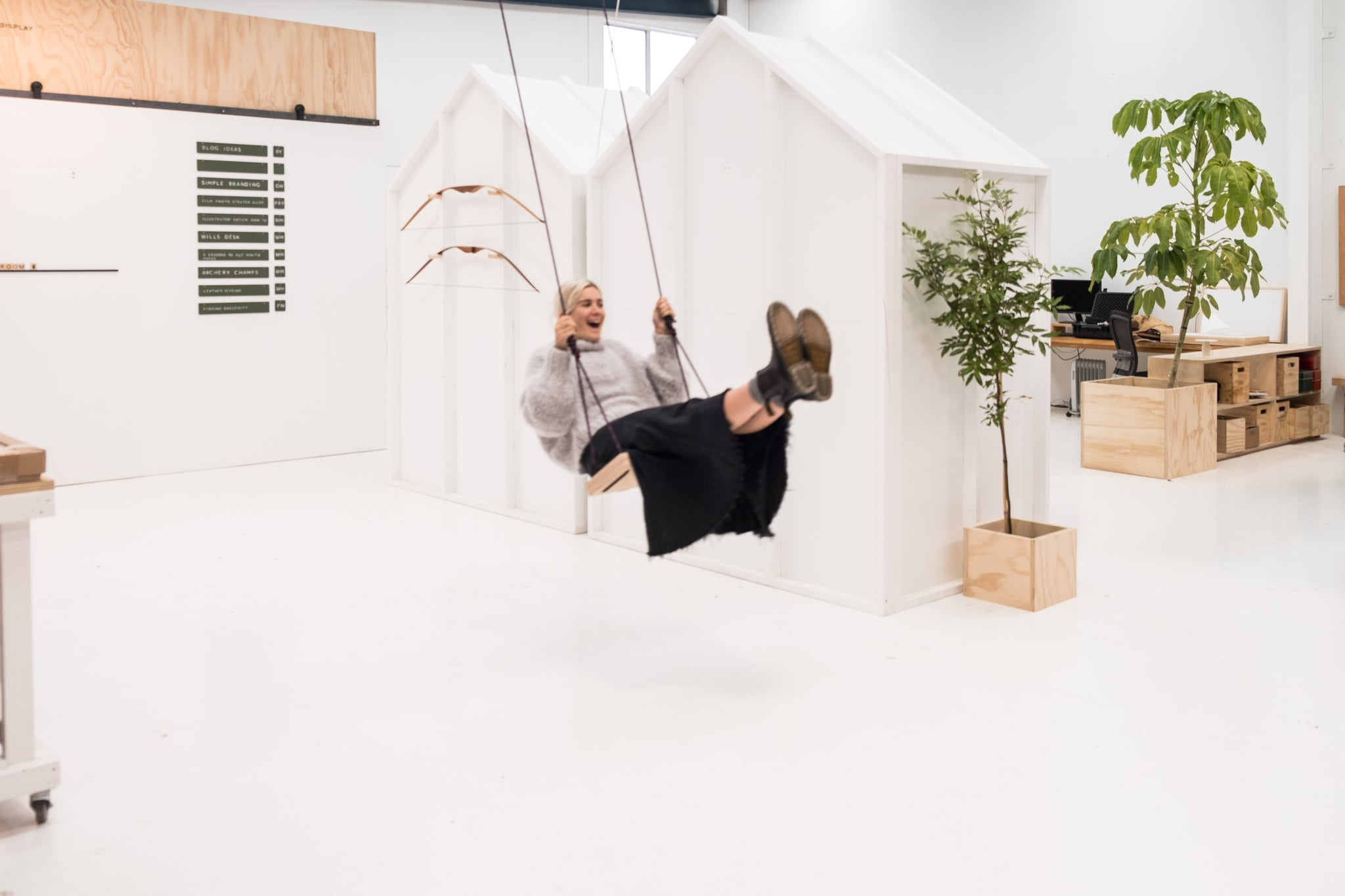 swing in white minimalistic office with house plants everywhere