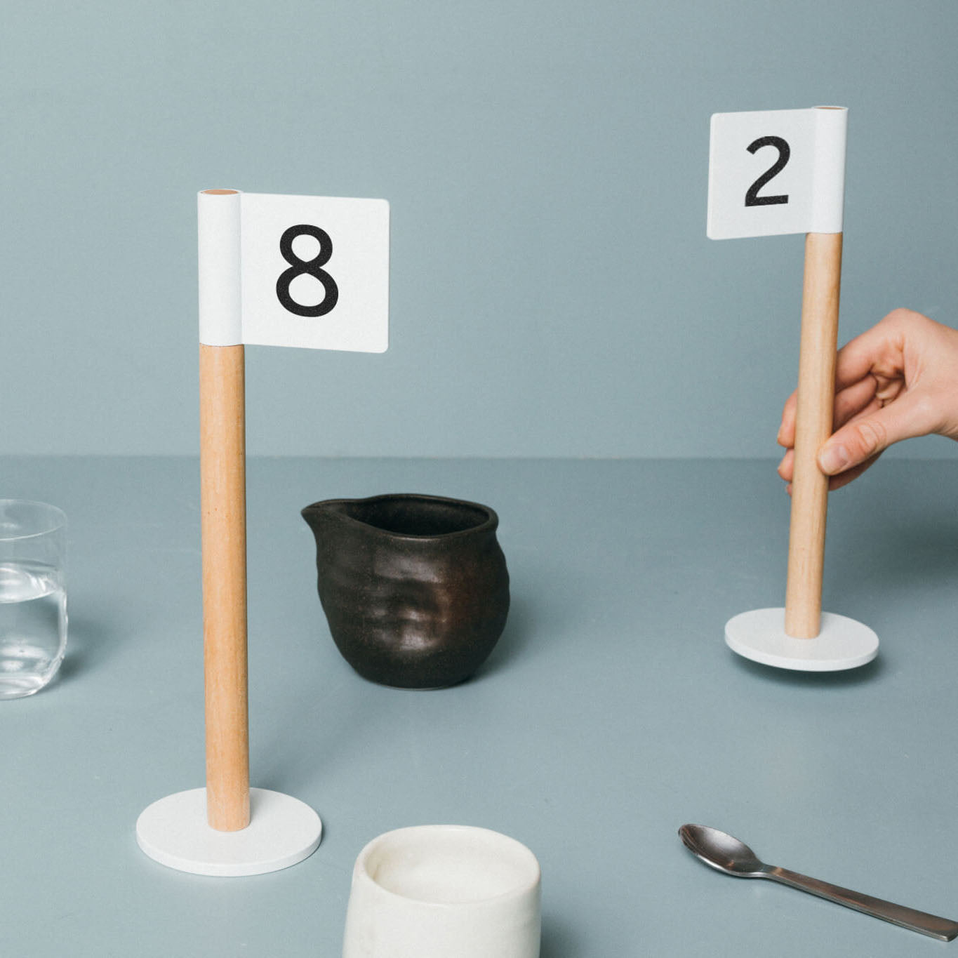 Small Table Numbers in the shape of flags, minimalist signs for restaurants and cafes made with aluminum and wood