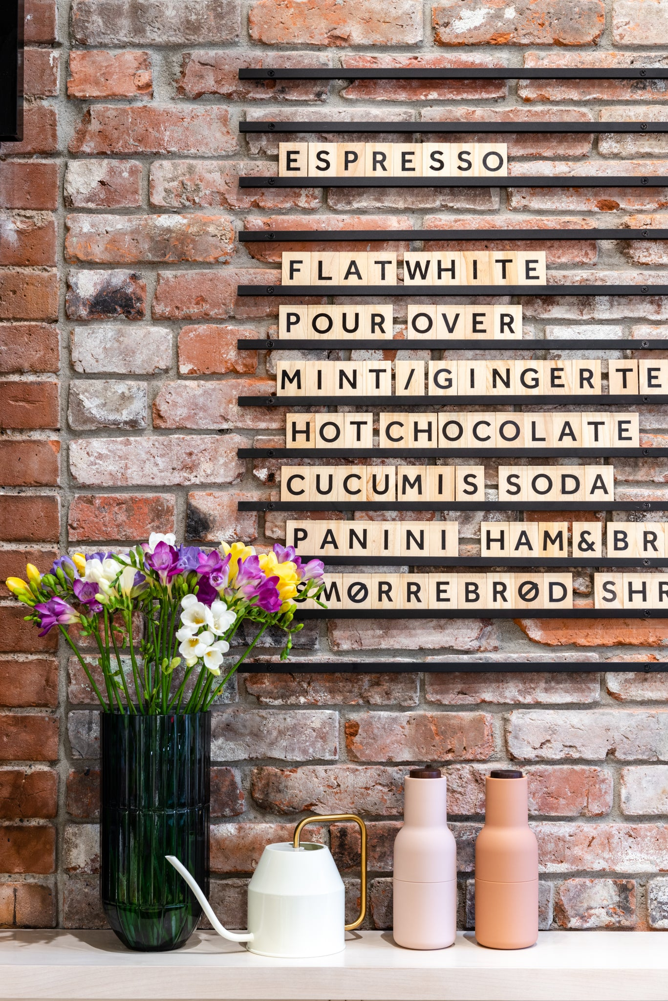 Wooden Letter Board On Brick Wall For A Cafe Menu