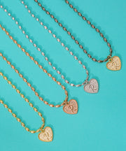 (F) Heart Initial Charm in Three Finishes