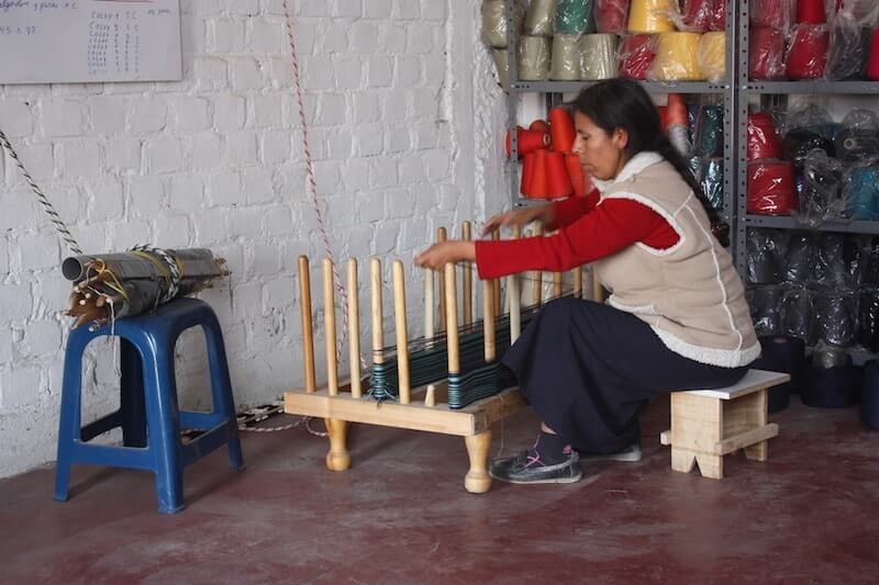 peruvian woman artisan working on a piece