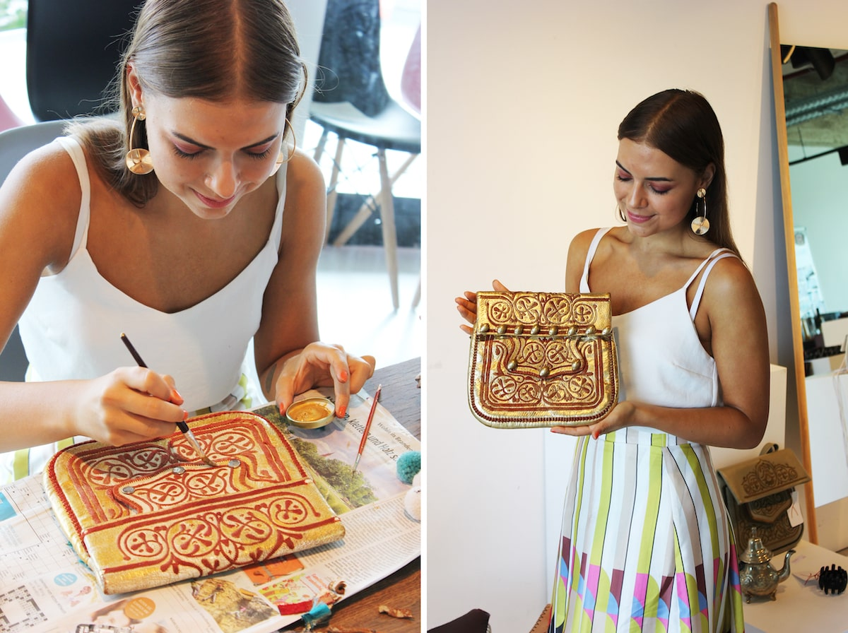 picture of someone painting on a vintage berber bag
