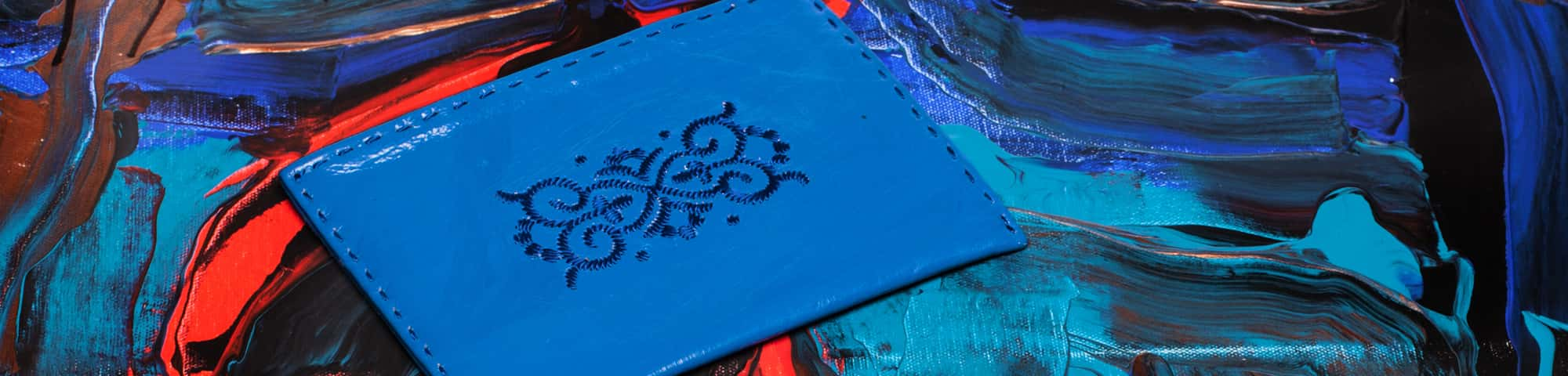 small christmas gift ideas: blue embroidered leather pouch
