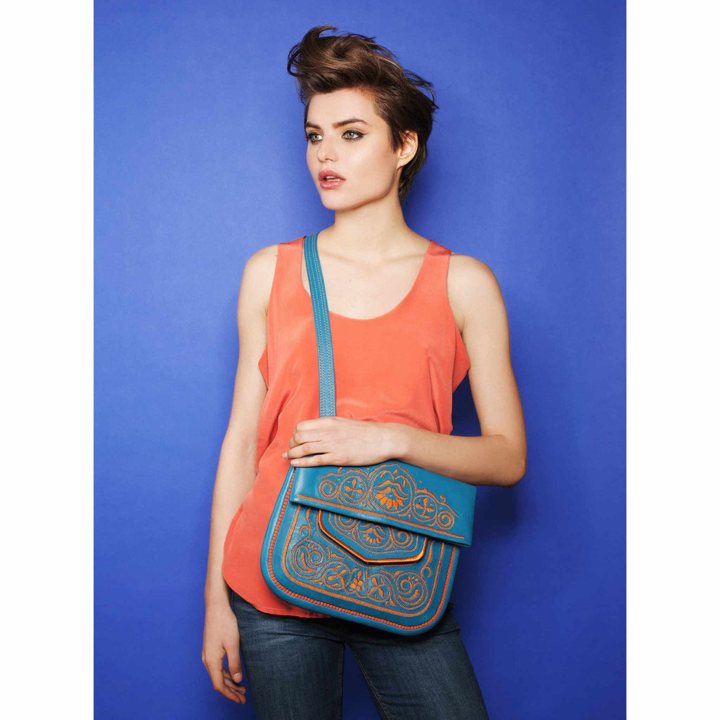 model wearing blue and orange embroidered ABURY Leather Berber Shoulder Bag