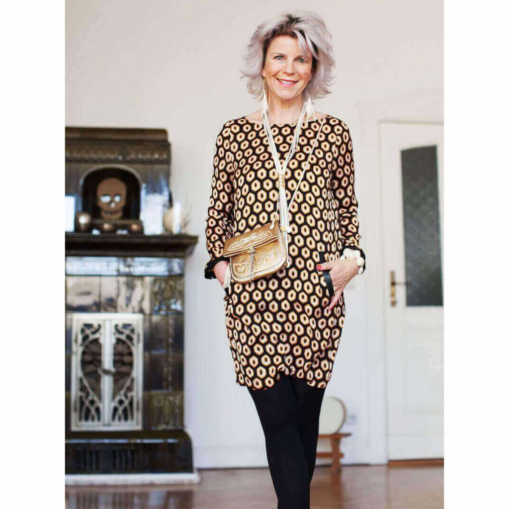 blogger wearing the gold embroidered ABURY Leather Berber Crossbody Bag