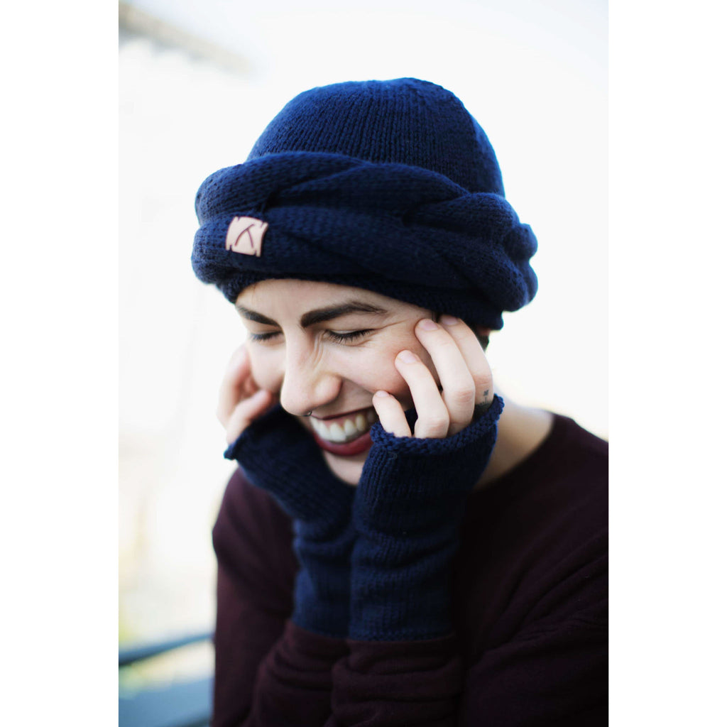smiling model wearing Navy Alpaca Wool Headband and finger-less gloves