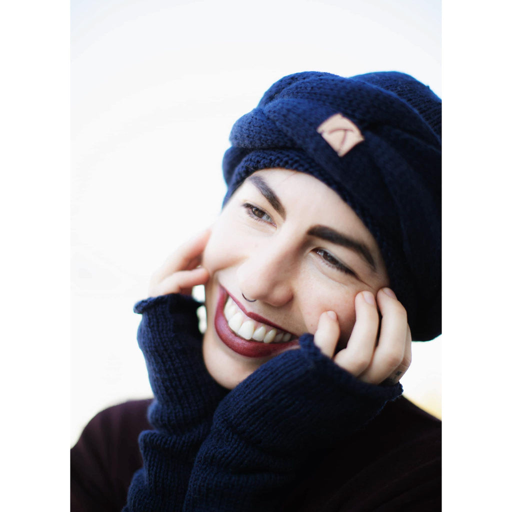 model smiling wearing Navy Blue Alpaca Beanie - handmade Accessories from Alpaca Wool - ABURY Collection Ecuador