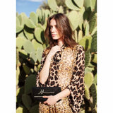 Model wearing black abury salam clutch bag