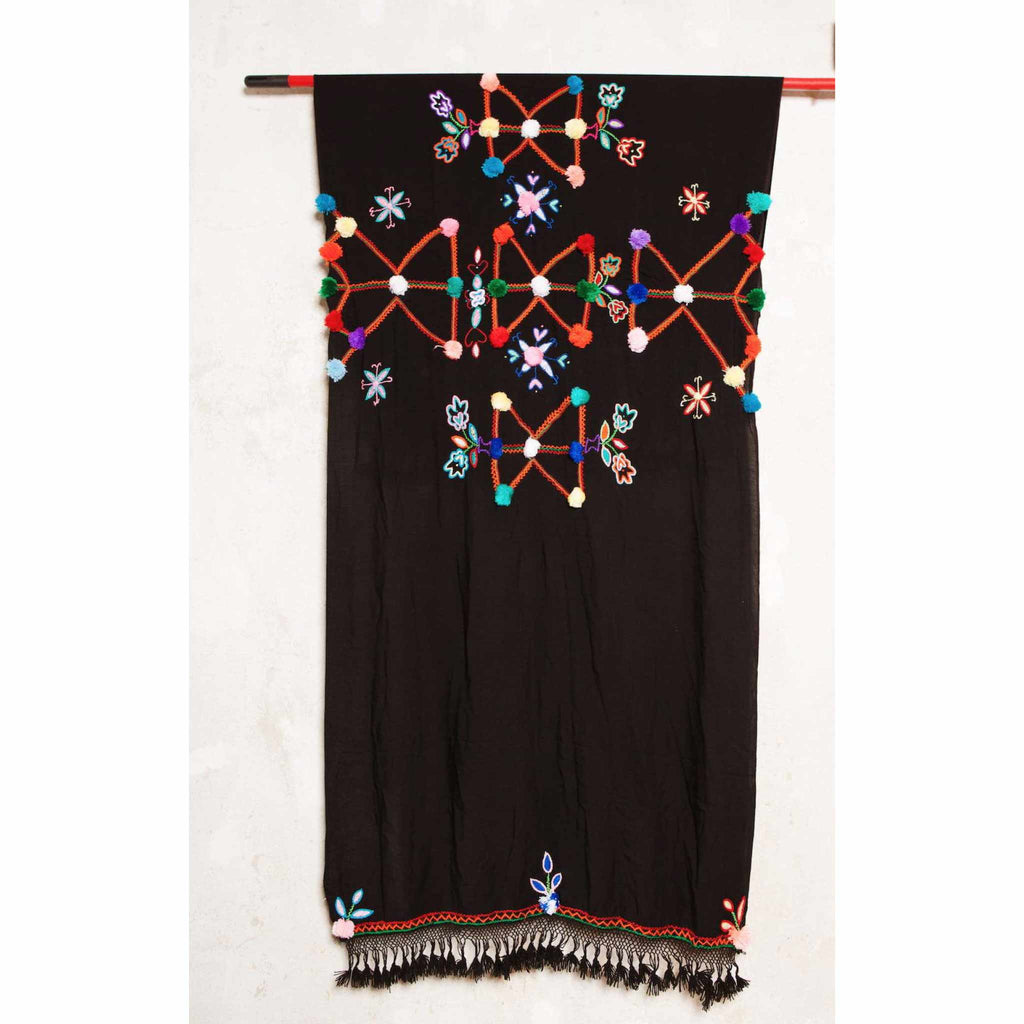 Colourful Eco-Friendly Moroccan Pompom Scarf hanging on a rope