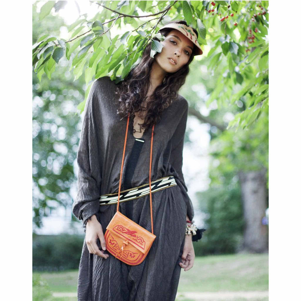 model wearing the orange and red embroidered ABURY Leather Berber Crossbody Bag
