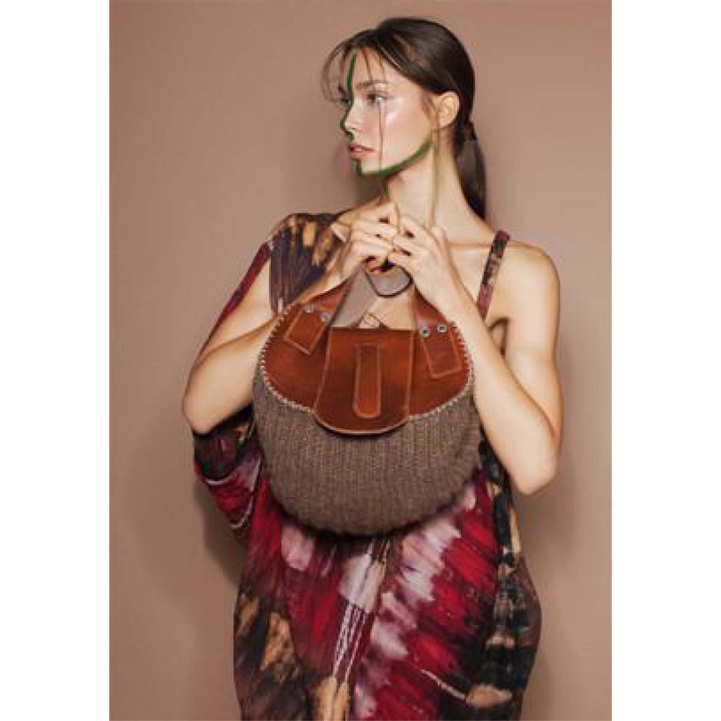 Model wearing Wool and Leather Mini Handbag Anita