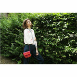 model wearing the pink and orange embroidered ABURY Leather Berber Mini Crossbody Bag