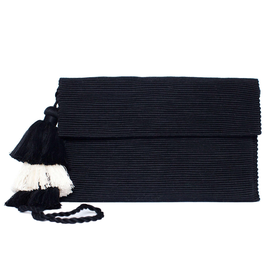 front view black abury cotton clutch bag with tassel