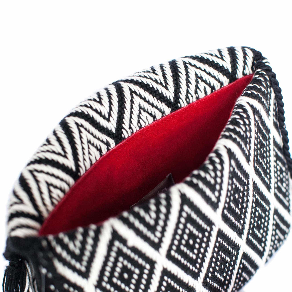 inside red part of the white and black abury zigzag cotton clutch bag