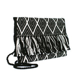 side view white and black abury zigzag cotton clutch bag