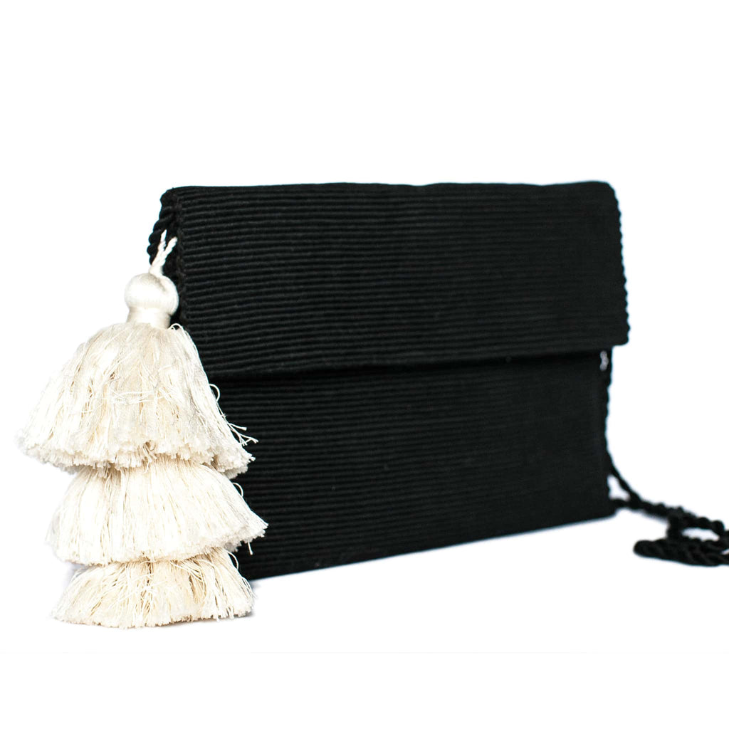 side view Black Cotton Clutch with White Tassel
