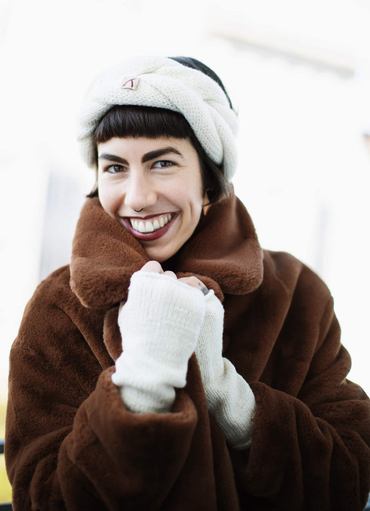 Happy model smiling wearing furry coat and dark red lipstick and Ivory Beanie and Finger-less Alpaca Gloves Set - Winter and Autumn Accessories - ABURY Collection Ecuador