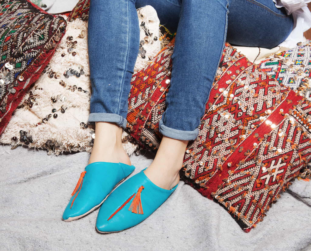 feet model wearing jeans and turquoise abury leather babouche leather slippers