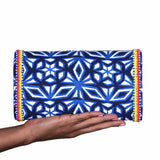 hand holding akbar delights atlantic clutch bag backside
