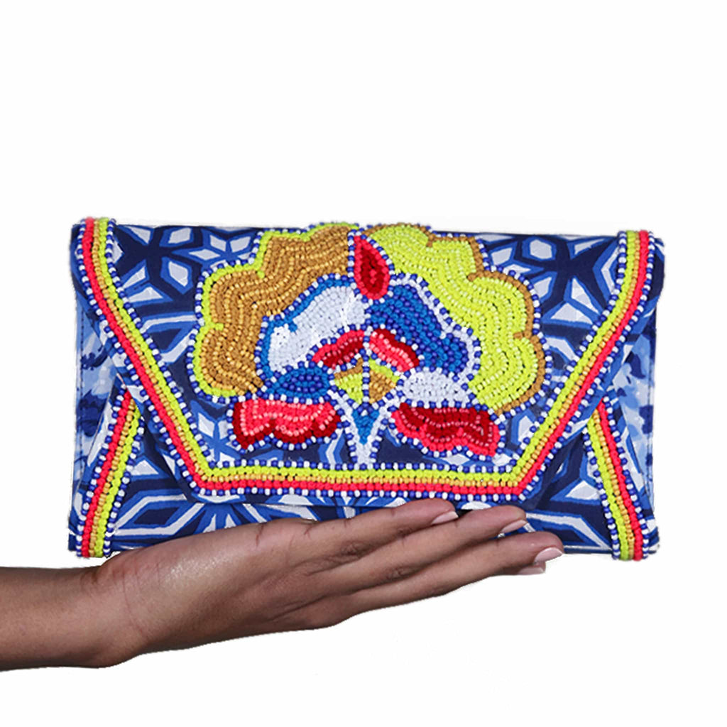 hand holding akbar delights atlantic clutch bag